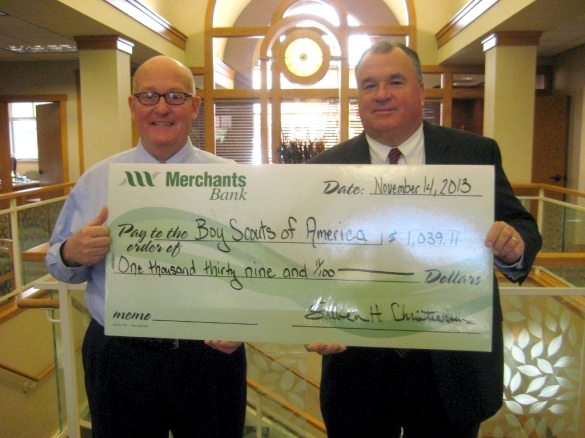 pictured are Steve Christiansen (l) of Merchants Bank and Sean Hennemann of the Gateway Area Council