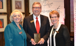 Pictured are Fatima Said, Project FINE Executive Director; Rod Nelson, Merchants Bank President and CEO; and Dr. Connie J. Gores, Project FINE 2013 Board President.
