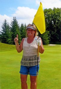 Machelle Anderson after a hole-in-one on the Pezhekee National golf course in Glennwood, MN.