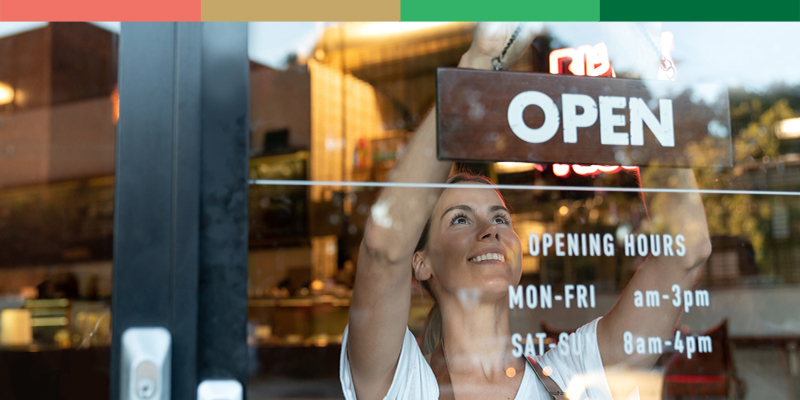 Businesswoman Hanging Open Sign