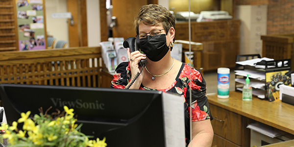 Employee On Phone Wearing A Mask